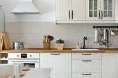 Interior shot from a white Scandinavian style white kitchen in an apartment.