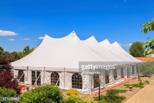 A white event tent in a garden
