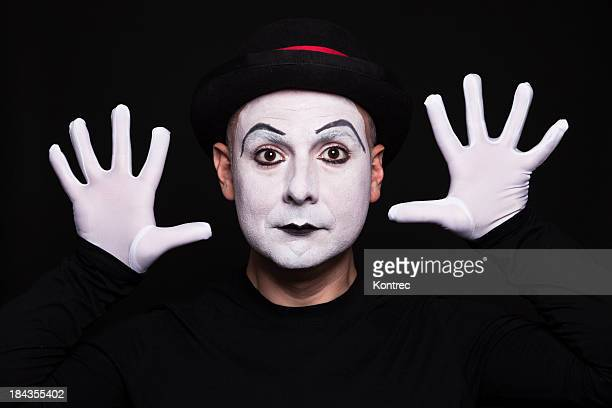 White face mime acting out moves