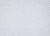 White felt texture. Blank fabric background. Detail of carpet material.