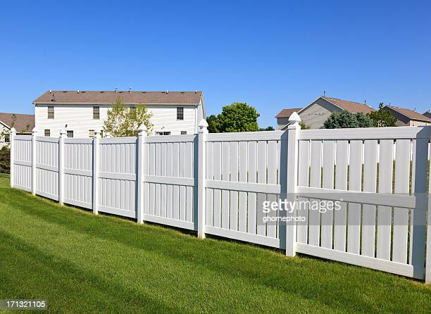 White fence in back yard
