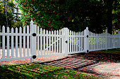 Long white picket fence.