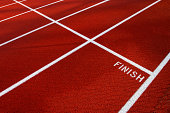 White finish line on red running track