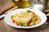 White fish fillet with vegetable stew, cod, sea bass, tilapia, perch, corn, broccoli, potatoes, bell peppers, beans, healthy food, delicious homemade lunch