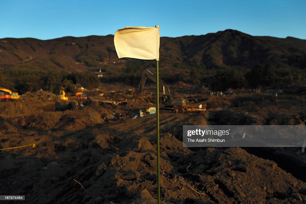 A white flag is placed at where the searching operation has finished on November 6, 2013 in Oshima, Tokyo, Japan. The early morning downpours from Typhoon Wipha, or No. 26 on October 16 caused landslides that covered 1.14 million square meters and damaged or destroyed 283 homes, according to estimates by Oshima town officials, 35 people confirmed dead and 5 still missing.