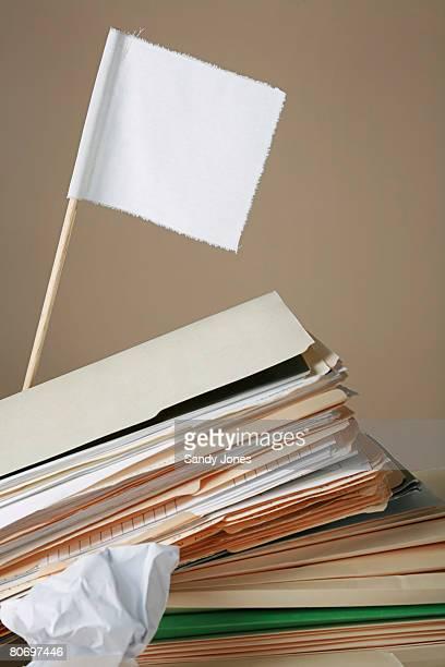 white flag over file folders