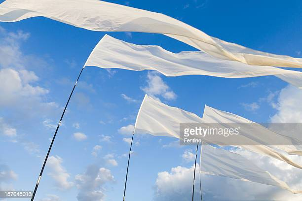 White Flags against blue Sky