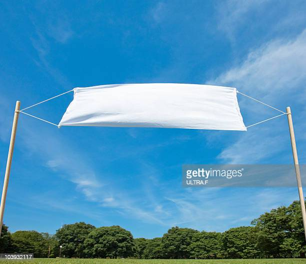 White flags waving in the sky.