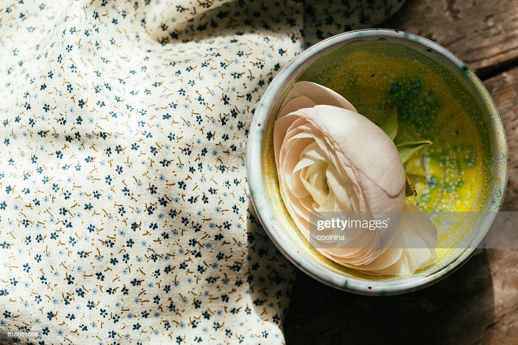 White floating ranunculus flowers. Spa wellness background Copy space : Stock Photo