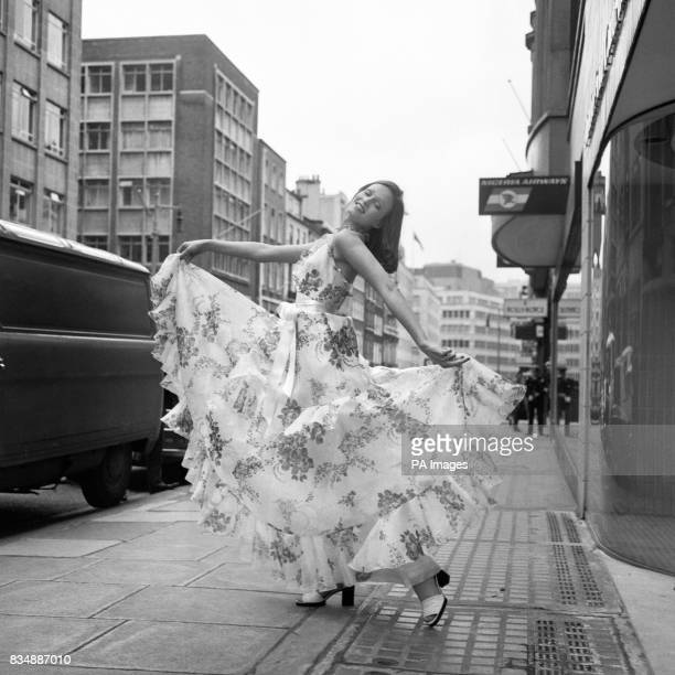White floral organza evening dress with halter neckline and tiered frilly skirt worn by Marion Cameron designed by Jorn Langberg