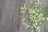 White flowers. Bouquet of gypsophila on a wooden background.