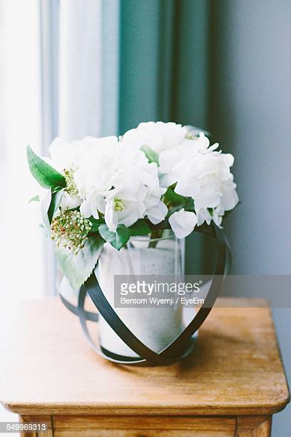 White Flowers In Vase On Table