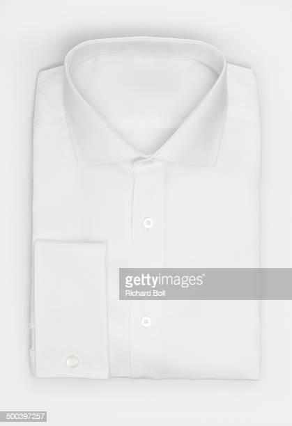 White folded shirt on a white background