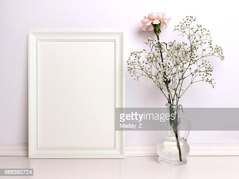 White frame mockup with flowers. : Foto de stock
