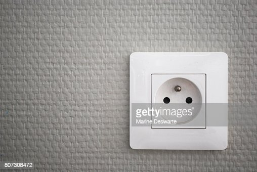 White french electrical outlet/plug on a wall. : Stock Photo