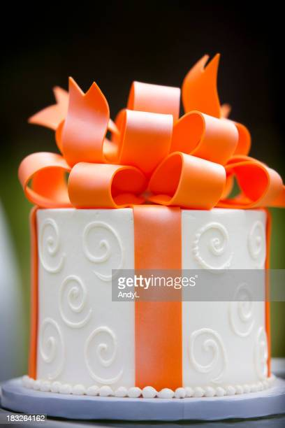 White Frosted Cake with Orange Marzapan Bow