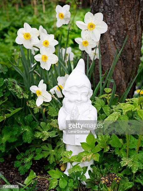A white garden gnome.