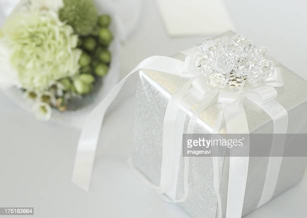 White gift box and a bouquet