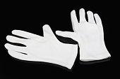 white gloves on a black background