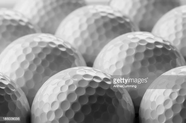 White golf balls in rows with selective focus