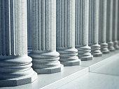 White Greek pillars along the road.