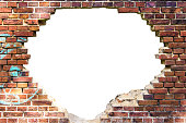 Wall of red bricks with a huge white hole in it, isolated on white