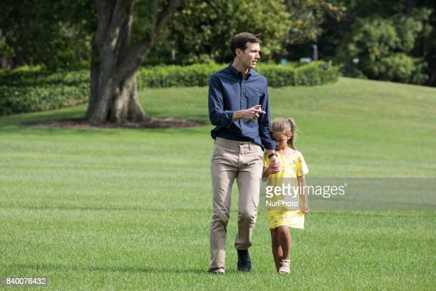 White House advisor Jared Kushner with his 6yearold daughter Arabella walk across the South Lawn after returning to the White House from a weekend at...