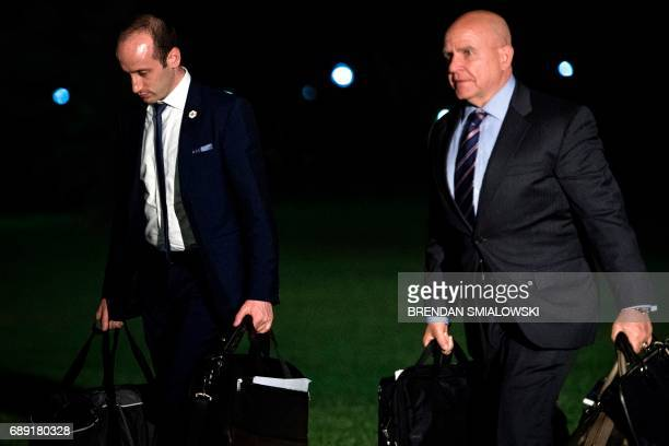 White House Advisor Stephen Miller and National Security Advisor HR McMaster walk to the White House from Marine One the South Lawn May 27 2017 in...