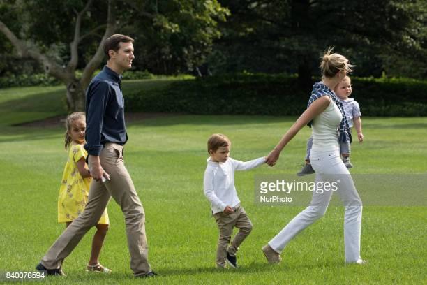 White House advisors Jared Kushner and Ivanka Trump with their children 6yearold Arabella 3yearold Joseph and 1yearold Theodore walk across the South...