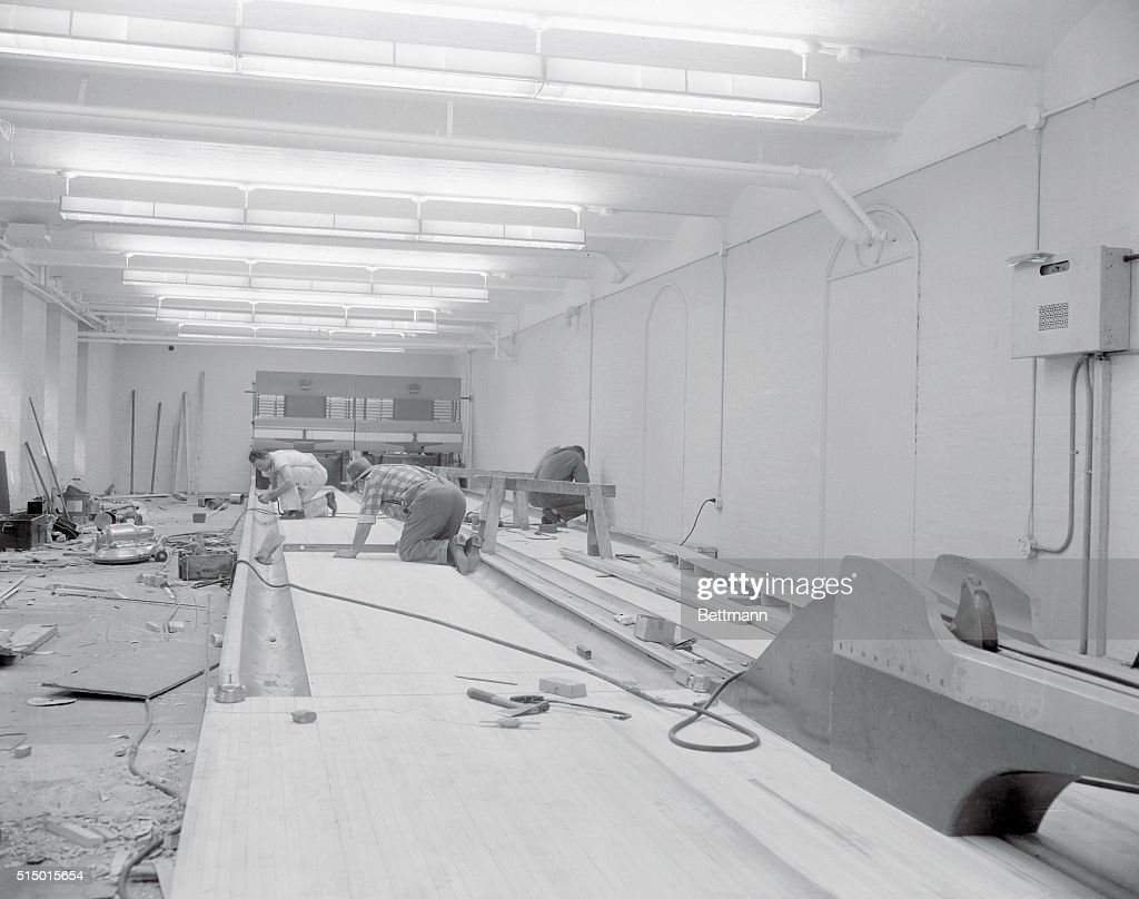workmen installing bowling alleys pictures | getty images