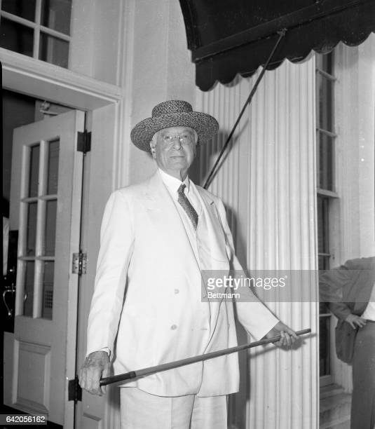 White House Caller Washington DC Wearing an unusual wide brim straw hat New York financier Bernard Baruch leaves the White House after calling on...