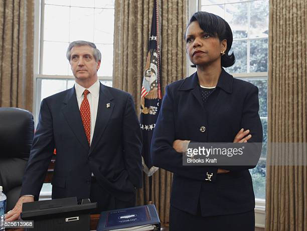 White House Chief of Staff Andy Card and National Security Advisor Condoleezza Rice listen as President George W Bush speaks to congressional leaders...