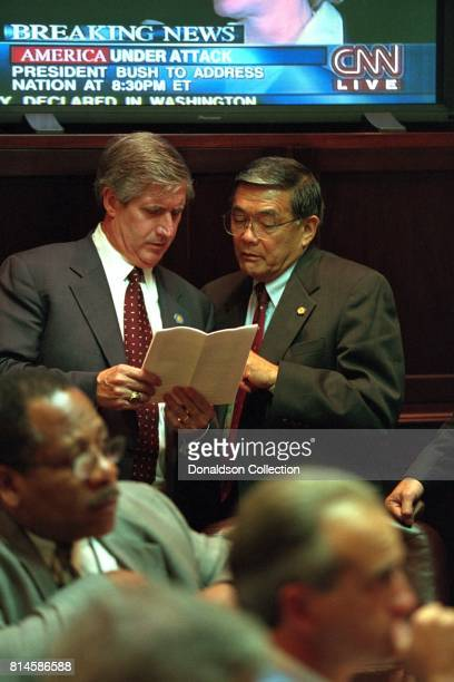 White House Chief of Staff Andy Card and Secretary of Transportation Norman Mineta confer in the Roosevelt Room of the White House Tuesday Sept 11...
