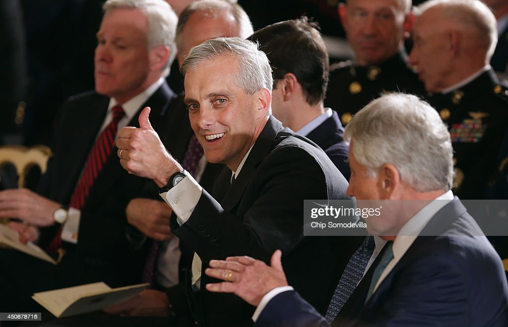 White House Chief of Staff <a gi-track='captionPersonalityLinkClicked' href=/galleries/search?phrase=Denis+McDonough&family=editorial&specificpeople=5759820 ng-click='$event.stopPropagation()'>Denis McDonough</a> gives a thumbs-up to members of Congress during retired Marine Cpl. William 'Kyle' Carpenter's Medal of Honor ceremony in the East Room of the White House on June 19, 2014 in Washington, DC. Carpenter received the medal for taking the blast from a grenade to protect fellow Marines and sustained major wounds. Carpenter is the eighth living recipient chosen for the high honor.