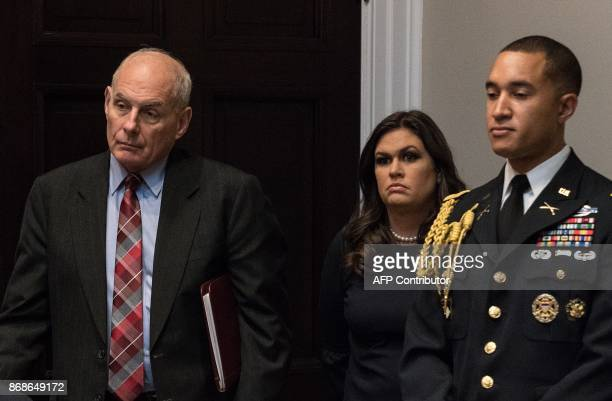 White House Chief of Staff John Kelly and Press Secretary Sarah Huckabee Sanders attend a meeting between US President Donald Trump and business...