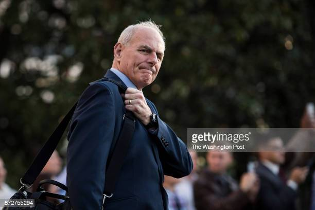 White House chief of staff John Kelly follows first lady Melania Trump and President Donald Trump across the South Lawn to Marine One for a trip to...