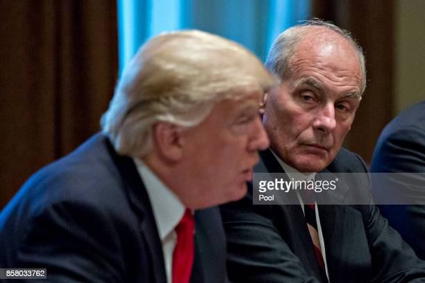White House chief of staff John Kelly listens as US President Donald Trump speaks at a briefing with senior military leaders in the Cabinet Room of...