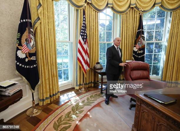 White House Chief of Staff John Kelly stands in the Oval Office while President Donald Trump meets with UN Secretary General António Guterres at the...