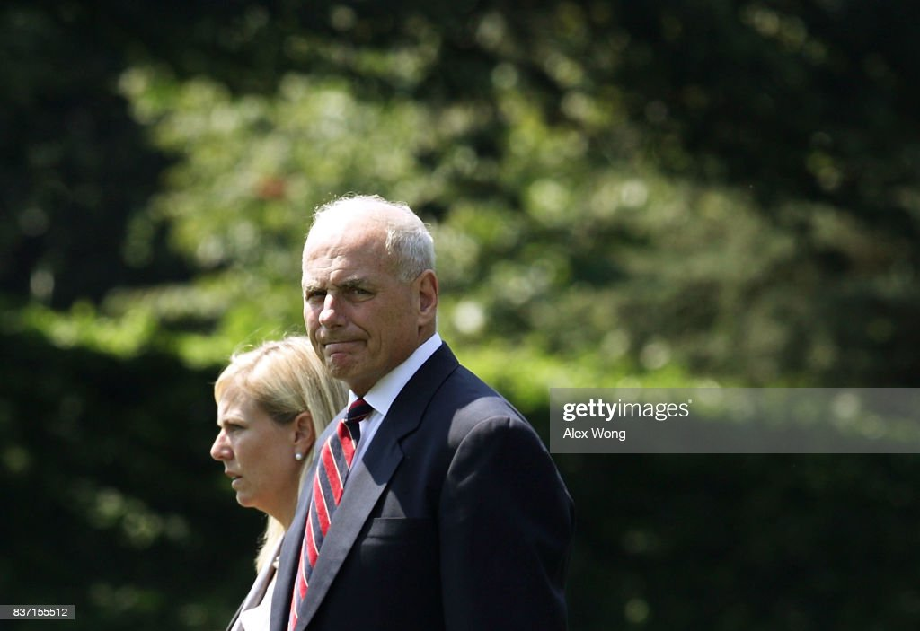 White House Chief of Staff John Kelly (R) walks towards the Marine One on the South Lawn for a departure from the White House August 22, 2017 in Washington, DC. President Trump was traveling for events in Arizona.