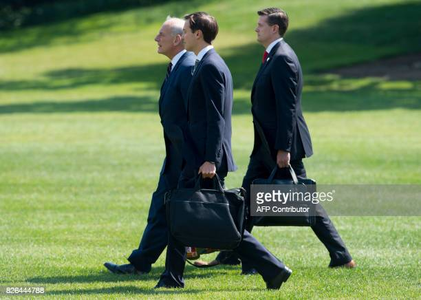 White House Chief of Staff John Kelly White House Staff Secretary Rob Porter and Senior Adviser Jared Kushner walk to Marine One prior to departure...