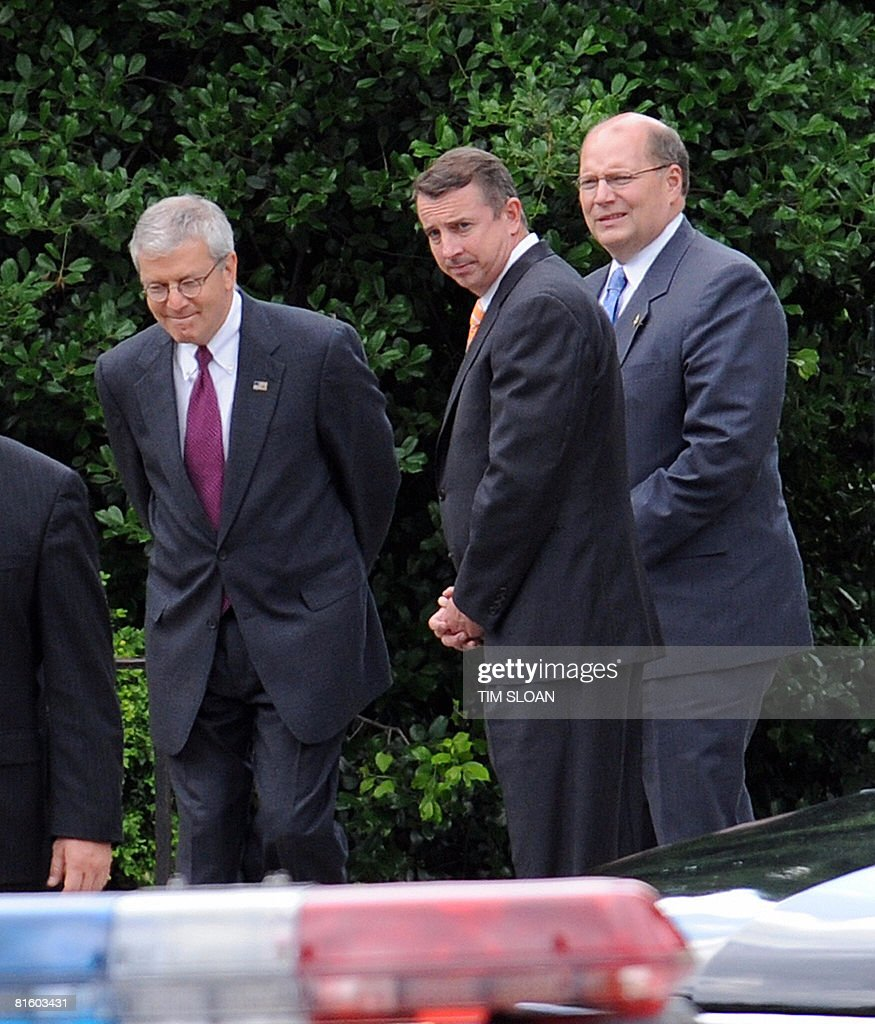 White House Chief of Staff Jousha Bolten (L), Counselor to the President Ed Gillespie (C) and Deputy White House Chief of Staff Joe Hagin (R) wait for US President George W. Bush to depart the wake for journalist Tim Russert on June 17, 2008 at the Saint Albans School in Washington, DC. Russert, who for 17 years quizzed and cajoled America's most powerful figures on the weekly current affairs program Meet The Press, died of a sudden heart attack on June 13 in NBC's Washington newsroom. Russert, 58, was NBC's Washington bureau chief and host of the longstanding Sunday program, where with his burly figure and arching eyebrows he pressed top politicians and bureaucrats on the hottest issues of the day. AFP PHOTO / TIM SLOAN