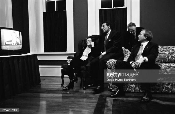 White House Chief of Staff Leon Pancetta and Press Secretary Mike McCurry watch election night returns with other members of Clinton's team backstage...