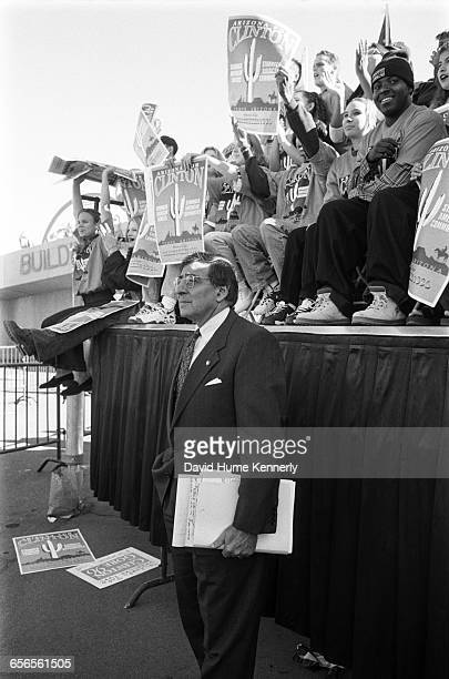 White House Chief of Staff Leon Panetta listens to President Bill Clinton speaking during his reelection bid at rally at Arizona State University...