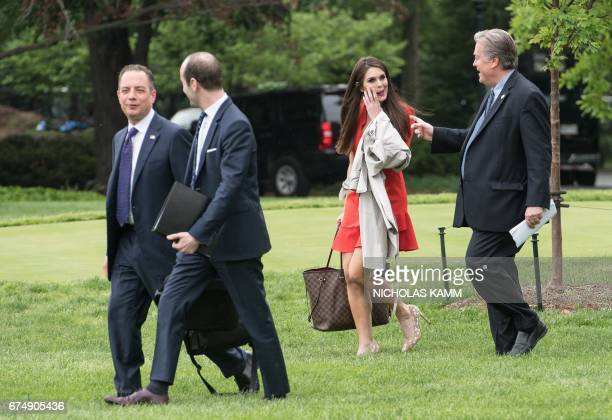 White House Chief of Staff Reince Priebus and advisers Stephen Miller Hope Hicks and Steve Bannon walk to board Marine One as US President Donald...