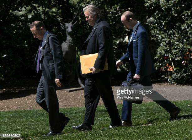 White House Chief of Staff Reince Priebus chief political strategist Steve Bannon and senior policital advisor Stephen Miller walk to a waiting...