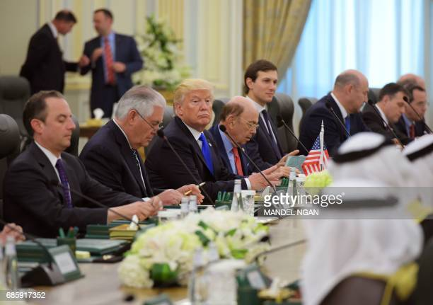 White House Chief of Staff Reince Priebus US Secretary of State Rex Tillerson US President Donald Trump and Commerce Secretary Wilbur Ross take part...