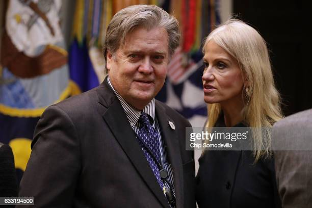 White House Chief Strategist Steve Bannon and Counselor to the President Kellyanne Conway wait for the arrival of US President Donald Trump for a...