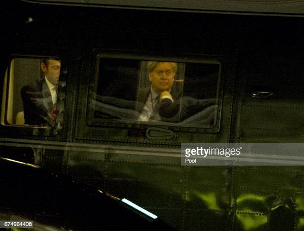 White House Chief Strategist Steve Bannon can be seen through the window of Marine One after it landed with he and President Donald Trump aboard on...