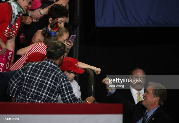 White House Chief Strategist Steve Bannon fist bumps a supporter prior to a 'Make America Great Again Rally' at the Pennsylvania Farm Show Complex...