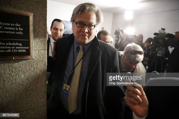 White House Chief Strategist Steve Bannon leaves a meeting of the House Republican caucus at the US Capitol March 23 2017 in Washington DC Bannon and...